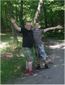 Two guys with arms outstretched